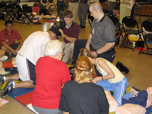 One of the groups performing CPR while a trainer watches. Click for larger image.